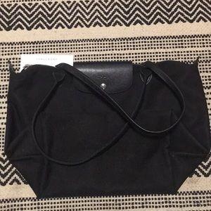 All black long champ bag